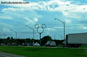 I always enjoy seeing this utility pole off of I-4 when driving by Disney. Finally got a photo.  Orlando, FL   A Retro Roadside photo - 2013