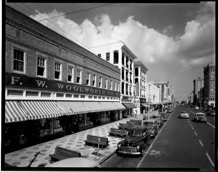 F.W. Woolworth Co., 551-567 Central Ave, facade of brick building along sidewalk with benches St. Petersburg, Fla. 2