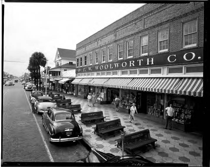 ...F.W. Woolworth Co., 551-567 Central Ave, facade of brick building along sidewalk with benches St. Petersburg, Fla.